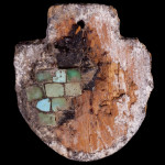 Shield shapped wooden pendant, with turquoise sets adhered on it