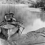 Historic photo of boat from the Powell Expedition, Colorado River