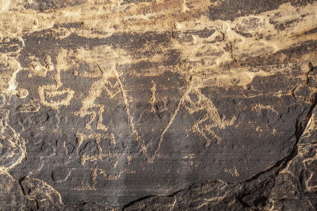 Pecked flute players and geometric shape, WACA 209 Panel A, Walnut Canyon