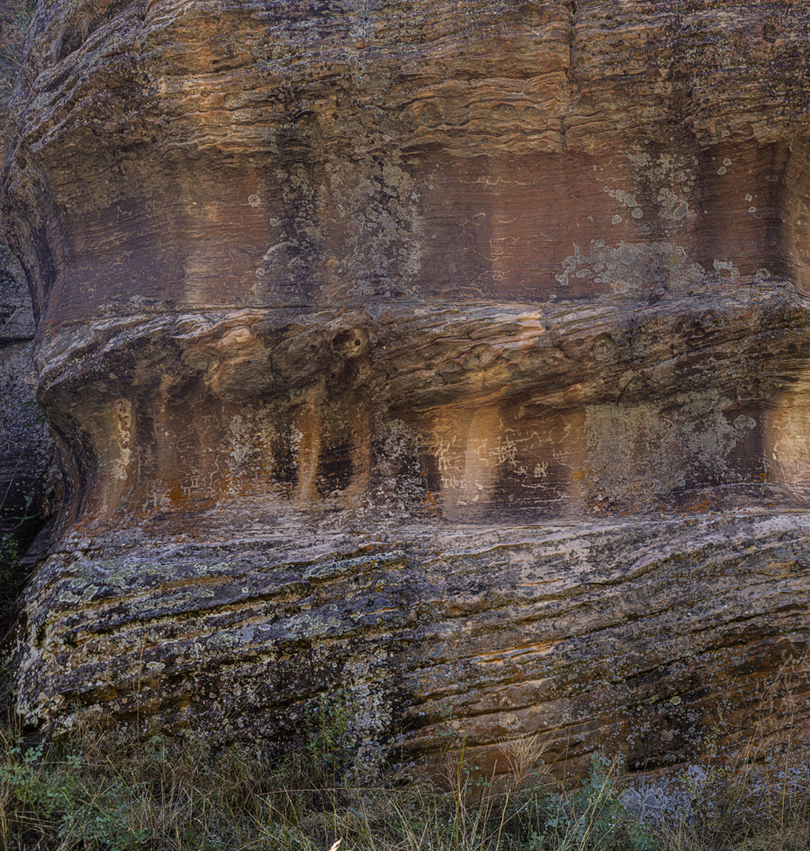 Crossbedded Coconino Sandstone with pecked petroglyphs, Walnut Canyon